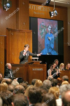 'Boy with a Pipe' painting at auction with auctioneer Tobias Meyer