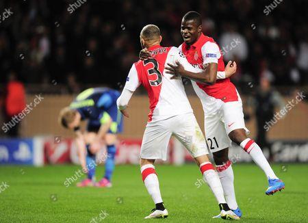 Layvin Kurzawa celebrates with Elderson Uwa Echiejile of AS Monaco at full-time