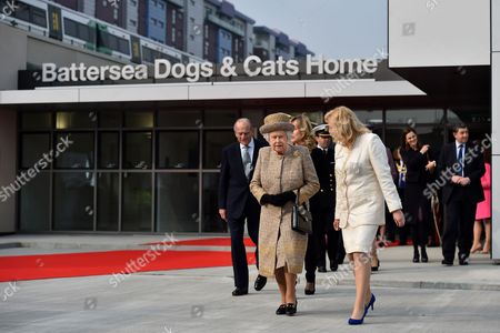 Stock Picture of Queen Elizabeth II (2nd L) and Prince Philip (L), Prince Philip are accompanied by Chief Executive Officer Claire Horton (3rd R) during a visit to Battersea Dogs and Cats Home
