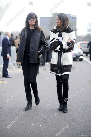 Stock Image of Emmanuelle Alt, Geraldine Saglio on avenue du Mahama Gandhi. after Louis Vuitton. Paris RTW Fall-Winter PFW FW15, Street Style Fashion.