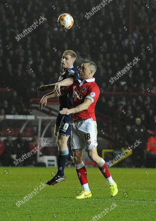Bristol City's Aaron Wilbraham battles for the high ball with Crewe AlexandraÕs Alan Tate