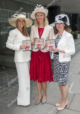 Founders Of Netmums.com Who Received An O.b.e. From The Duke Of Cambridge At Buckingham Palace. L-r Siobhan Freegard Age 46(white Suit) From Harrow Sally Russell Age 47( Red Dress) From Watford And And Catherine Court Age 47 ( Black And White Dress) From Tring 04.03.14 Reporter Claire Ellicott.