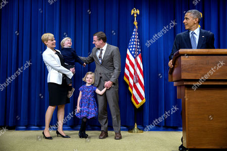 President Barack Obama introduces the family of Jeff Eggers, Senior Director for Afghanistan and Pakistan, before presenting Eggers with the Colonel Samuel Nelson Drew Memorial Award in the Eisenhower Executive Office Building South Court Auditorium
