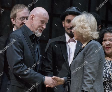 Anthony Warlow shares a few words with Camilla Duchess of Cornwall greets the actors on stage during a visit to the Shakespeare Theatre Company at Sidney Harman Hall in Washington, D.C..