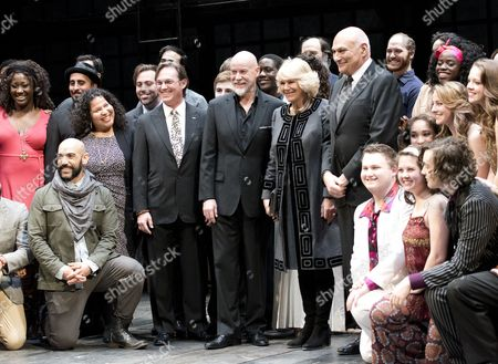 Stock Photo of Camilla Duchess of Cornwall, poses for a photo with the actors on stage during a visit to the Shakespeare Theatre Company at Sidney Harman Hall in Washington, D.C.. Richard Thomas, Anthony Warlow, Camilla Duchess of Cornwall, and Michael Kahn are identifiable at the center of the photo.