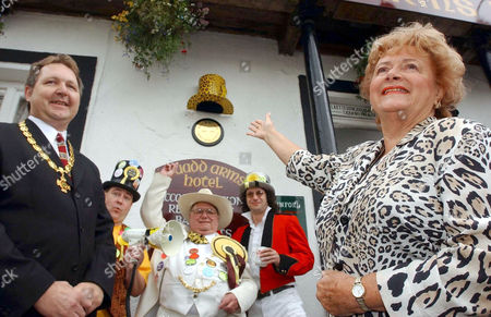 Cynthia Payne unveils a memorial to the late Screaming Lord Sutch ahead of the annual Man v Horse race
