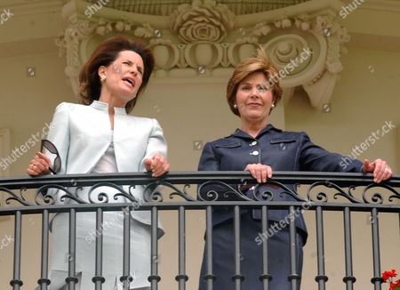 Nancy Goodman Brinker, left, and First lady Laura Bush, right, watch the departure of Marine One from the Truman Balcony at the White House