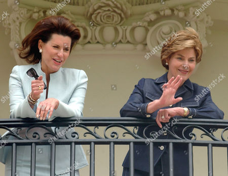 Stock Picture of Nancy Goodman Brinker, left, and First lady Laura Bush, right, watch the departure of Marine One from the Truman Balcony at the White House