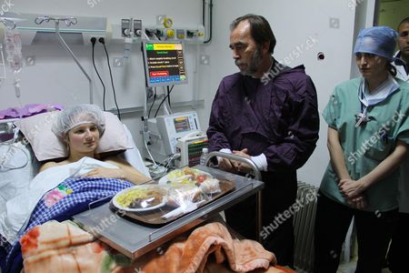 Said Aidi greets a woman injured during the attack