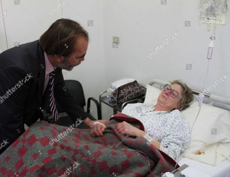 Stock Photo of Said Aidi greets a woman injured during the attack