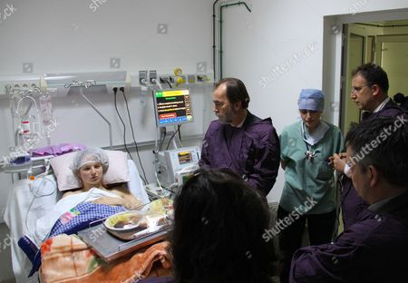 Stock Picture of Said Aidi greets a woman injured during the attack