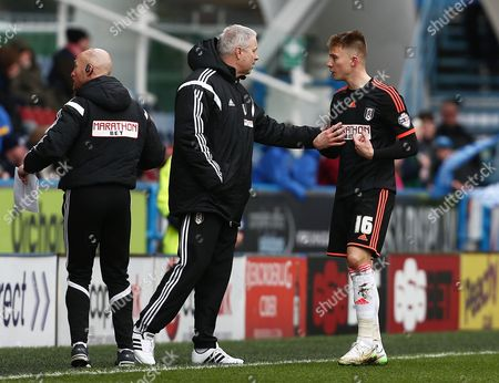 Cauley Woodrow of Fulham has a word with manager Kit Symons after he was shown a red card but the decision was later changed by referee Mr Richard Clark