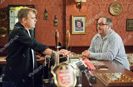 Stock Photo of Michelle Connor [KYM MARSH]  assures Steve McDonald [SIMON GREGSON] that he has her blessing and should visit Peter in prison. Dean [JUSTIN MOORHOUSE] (landlord of the Flying Horse) comes into the Rovers and brags to Steve about how good business is in   his pub. When Steve then suggests they could hammer his pub team at cricket, Dean tells him another