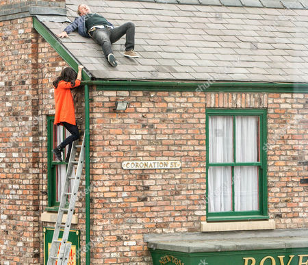 Ext Street  Neil Beckett [WILL TRAVIS] climbs onto the roof of the Rovers, insisting he'll only speak to Andrea Beckett [HAYLEY TAMADDON]. Stranded Tim's forced to watch on as Neil tells Andrea he'll only agree to come down if she breaks off her engagement to Lloyd Mullaney [CRAIG CHARLES] and returns to him. Incensed, Andrea climbs up the ladder and begs him to stop messing about. But when she slips and is left clinging to the guttering, it looks like Neil's stunt could have very serious consequences?