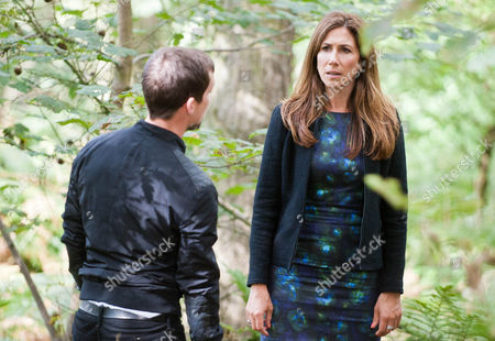 Stock Photo of Megan Macey [GAYNOR FAYE] and Robbie Lawson [JAMIE SHELTON] get to the cottage but with Declan and Charity not there Megan and Robbie continue to look for them nearby.