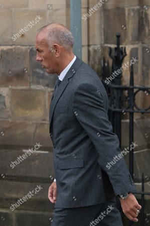 Mark Hateley arrives for the funeral.