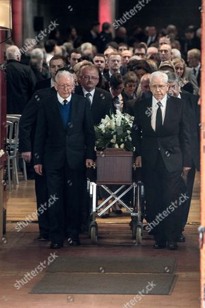 Dave MacKay's coffin leaves the service, followed by his family.