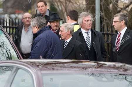 Colin Kidd and Pat Jennings arrive for the funeral.
