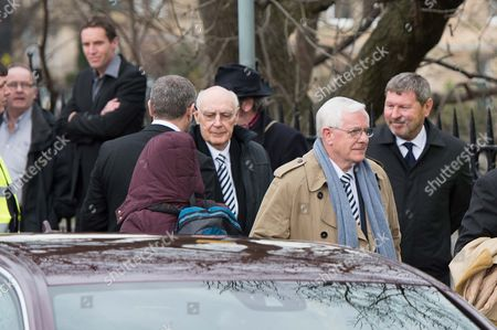 Stock Image of Alan Gilzean, and Alan Mullery arrive for the funeral.