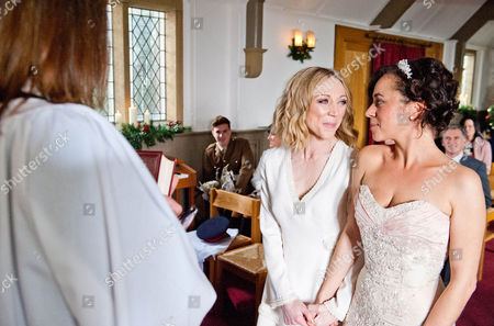 It's the day of Ali Spencer [KELLI HOLLIS] and Ruby Haswell's [ALICYA EYO] wedding and Kerry is eager to start Ali's make up. But things go awry when Ali takes a call from the registry office saying they've cancelled the wedding, as the registrar has died. Ruby arrives to Ali and Dan trying to find another registry office. Harriet Finch [KATHERINE DOW-BLYTON] takes the plunge by suggesting they still have a blessing from her but later tells Ali they should just go the full hog, and have a proper wedding. But Ashley worries without the Bishop's permission Harriet will get into trouble.  Ruby and Ali walk down the aisle of the church with Sean Spencer [LUKE ROSKELL].  Soon there is more commotion when the police arrive at the church and everyone gathers as DI Bails [ROCKY MARSHALL] arrests the vicar Harriet.   Photographer -Amy Brammall