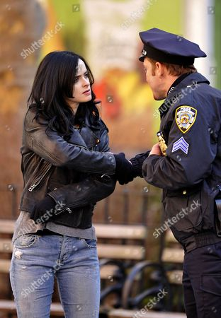 Krysten Ritter and Wil Traval in NYPD uniform