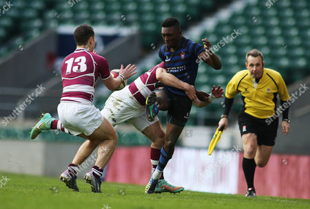 Reece Pinnock of Dulwich College is tackled by Blake Edwards of Bromsgrove School.