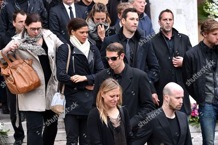French freestyle swimmer, Coralie Balmy (L, 3rd Line), Former French swimmer, Laure Manaudou (C-4th line), Former French swimmer, Alain Bernard (C-2nd line) attend the funeral of Camille Muffat, the olympic gold medallist swimmer, during a private ceremony at St Jean-Baptiste-Le Voeu church after being repatriated from Argentina over the weekend along with the seven other French nationals who died in a helicopter crash