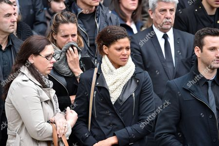 Former French Olympic, world and European champion swimmer, Laure Manaudou (L-back) and French freestyle swimmer, Coralie Balmy (R) attend the funeral of Camille Muffat, the olympic gold medallist swimmer, during a private ceremony at St Jean-Baptiste-Le Voeu church after being repatriated from Argentina over the weekend along with the seven other French nationals who died in a helicopter crash