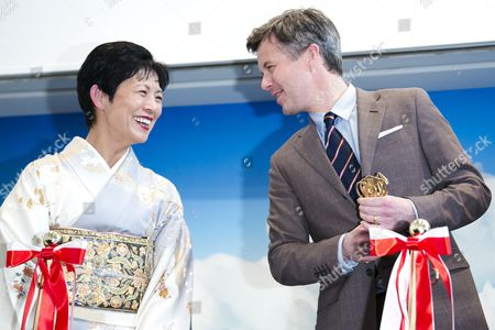 """Princess Hisako Takamado talks with Crown Prince Frederik Andre Henrik Christian during the opening ceremony of the exhibition """"The Spiritual Greenland"""" at Hillside Forum in Daikanyama"""