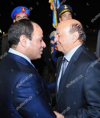 Egyptian President Abdel Fattah al-Sisi welcoming Yemen's President Abd Rabbuh Mansur Hadi