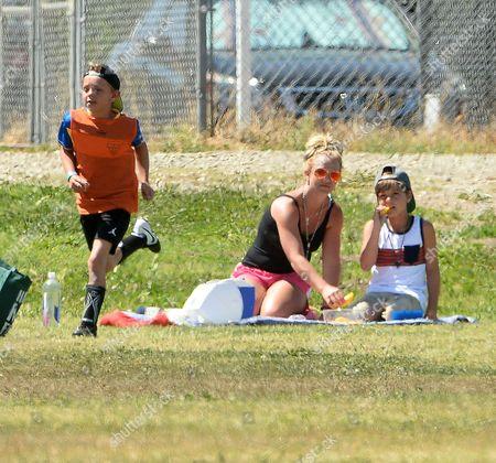 Stock Picture of Britney Spears and son Sean Federline watching Jayden Federline playing footbal