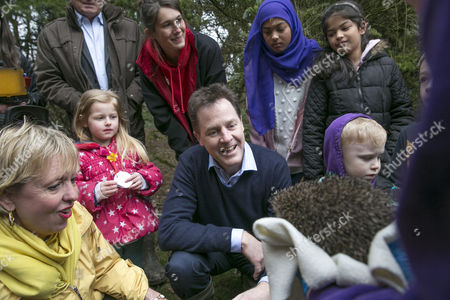 Lorely Burt and Nick Clegg meeting a rescued hedgehog