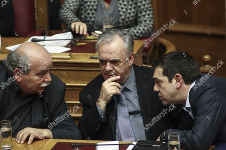 Greece's Prime Minister Alexis Tsipras, right, talks with Vice President of the Government Yannis Dragasakis, center and Interior Minister Nikos Voutsis