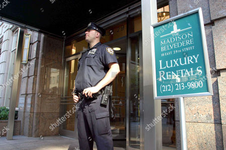 Police officer outside the home of Eric Douglas in Manhattan