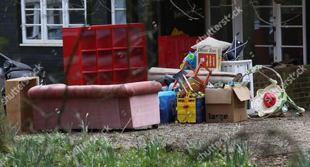 Pile of possessions outside the house