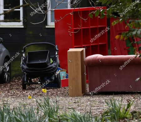 Stock Picture of Pile of possessions outside the house