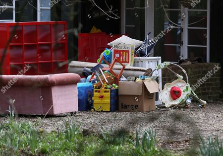 Stock Photo of Pile of possessions outside the house