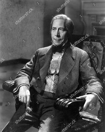 George Arliss on-set of the Film, The House of Rothschild, 1934