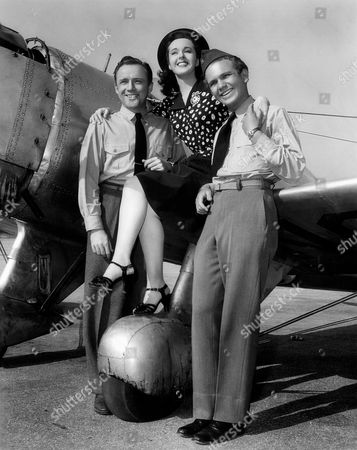 Stock Picture of Frank Albertson, Peggy Moran and Frankie Thomas, Publicity Portrait, on-set of the Film, 'Flying Cadets', 1941