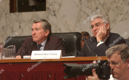 Former Secretary of the Navy, John Lehman, and Richard Ben Veniste, listen to CIA Director George Tenet testify.