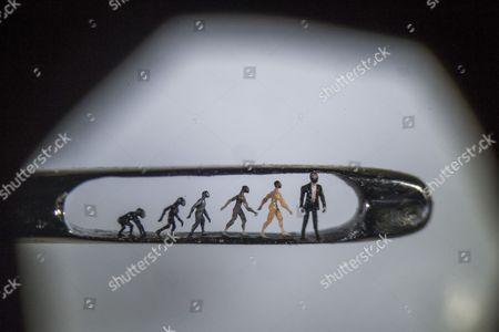 Willard Wigan microscopic art in the eye of a needle viewed under a microscope