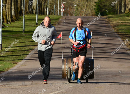 Mike Tindall joins Rob Edmond running with a Bell's whisky barrel