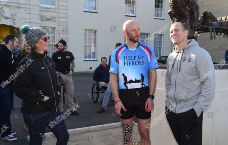 Rob Edmond with Zara Tindall and Mike Tindall after completing the challenge