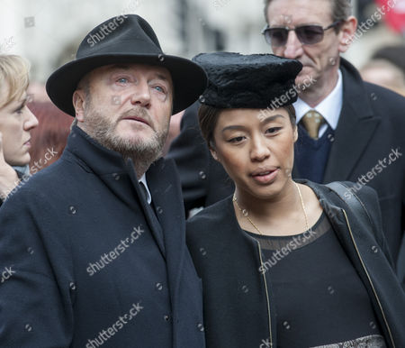 George Galloway Attends The Funeral Of Tony Benn At St Margaret's Church In Westminster With His Fourth Wife Putri Gayatri Pertiwi.