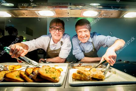 Stock Image of Michael Crockart and Willie Rennie serving up some food in the cafe