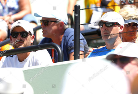Dani Vallverdu and Jez Green, ex coach and fitness trainer of Andy Murray, sit in Tomas Berdych's box during the Miami Open, Florida, USA, 2015