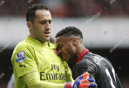 Raheem Sterling of Liverpool and Ryo Miyaichi of Arsenal