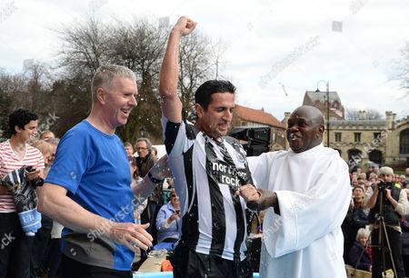 The Archbishop of York, Dr John Sentamu baptises Christian Pillai during an Easter ceremony