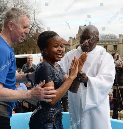 The Archbishop of York, Dr John Sentamu baptises Fiyinfowwa Babatunde during an Easter ceremony