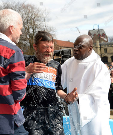 The Archbishop of York, Dr John Sentamu baptises John Youll during an Easter ceremony